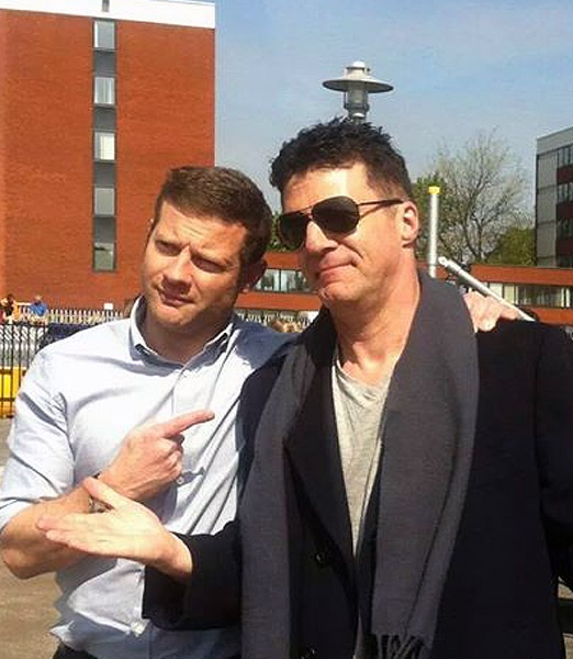 Andy Monk as Simon Cowell